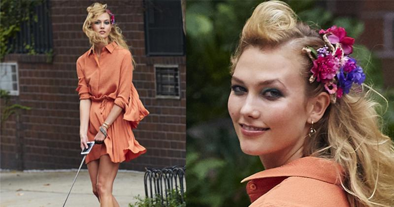 Karlie Kross i en snygg aprikosfärgad klänning